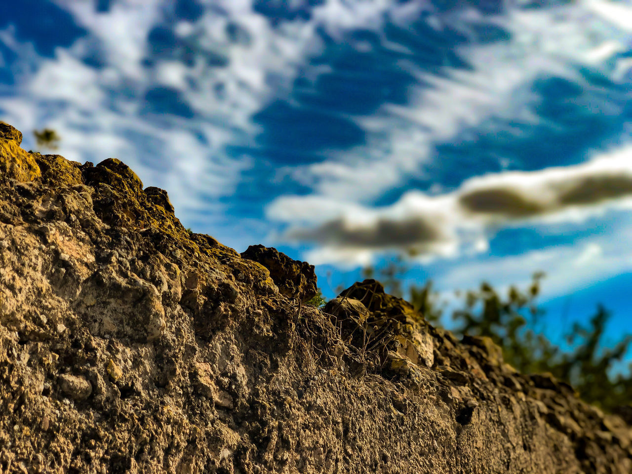 rock, rock - object, cloud - sky, sky, solid, low angle view, nature, tranquility, textured, no people, day, beauty in nature, focus on foreground, rough, rock formation, outdoors, selective focus, mountain, close-up, tranquil scene