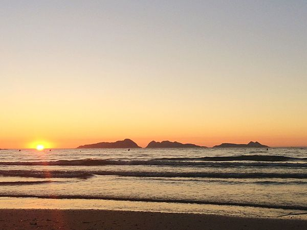 Sunset Sea Scenics Tranquil Scene Vacations Water Beach Tourism SPAIN Galicia Islands Cies Islands Orange Color Tranquility Sun Mountain Copy Space Travel Atmosphere Non-urban Scene Romantic Sky Idyllic