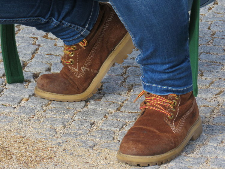 Blue Jeans Boot Boots Brown Boots Canvas Shoe Check This Out Cobblestone Day EyeEm Best Shots Feet Footwear Girl With Green Jacket High Angle View Jeans Lifestyles Low Section Outdoors Pair Part Of Person Personal Perspective Simplicity Standing Woman Showcase April