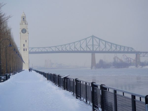 Architecture Bridge Bridge - Man Made Structure Built Structure Clock Face Clock Tower Clocktower Cold Temperature La Ronde Montreal Canada Montreal Old Port Montreal, Canada Montrealcity Montréal Sky Snow Snowing St Lawrence River Walk Walkway Walkways  Water Winter
