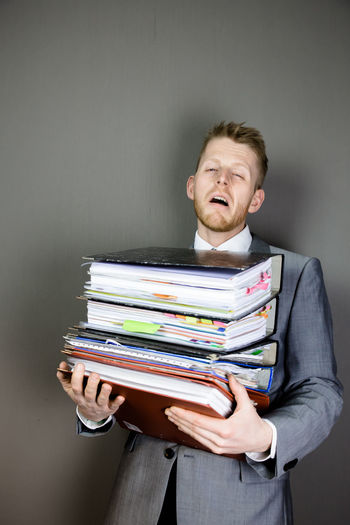 stressed Business Carrying Man Adult Business Business Person Businessman Document Files FilesFolder Men One Person Young Man