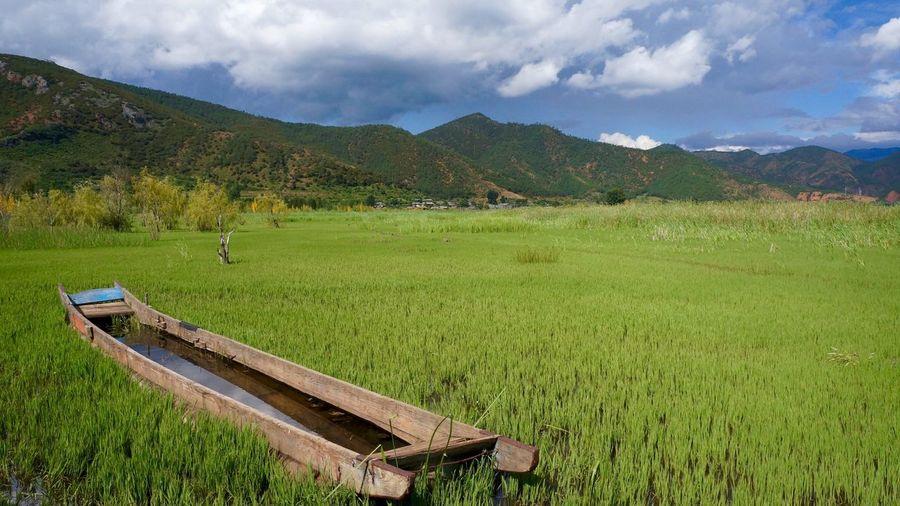 The Great Outdoors - 2016 EyeEm Awards Grass Water Boat Mountains Mountain Outdoors Yunnan Yunnan ,China China