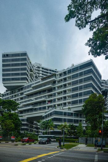 Street by buildings against sky in city