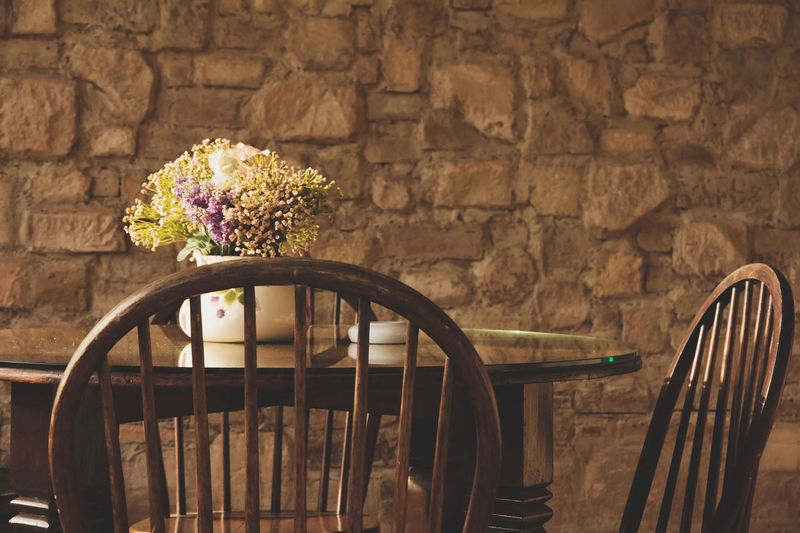 vintage chair and table with flower Dining Room Home Decoration  Close-up Day Dining Table Diningroom Flower Fragility Freshness Home Decor Home Decorating Indoors  Interior Design Nature No People Wooden Chair Wooden Furnitures