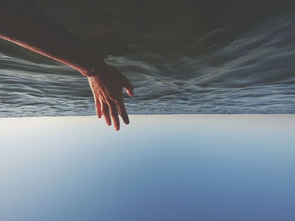 Inverted photo in the sea Human Hand Human Body Part Inverted Photography Inverted Image On The Sea Human Arm Fingers Abstract Day Blue Sky Carcavelos Portugal Carcavelos Beach Carcavelos Pixelated Water Technology Winter Underwater Cold Temperature Wireless Technology Sky Close-up Tranquil Scene Shore Ocean The Great Outdoors - 2018 EyeEm Awards