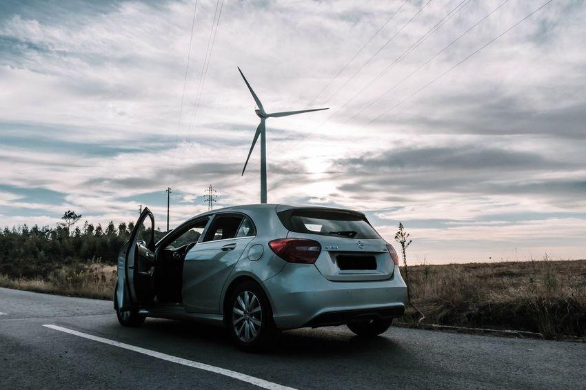 Let's go? Car Travel Roadtrip Road Mercedes Mercedes-Benz Sunset Technology Rural Scene Power In Nature Alternative Energy Road Destruction Danger Social Issues Sky Cloud - Sky Wind Power Wind Turbine Renewable Energy Sustainable Resources