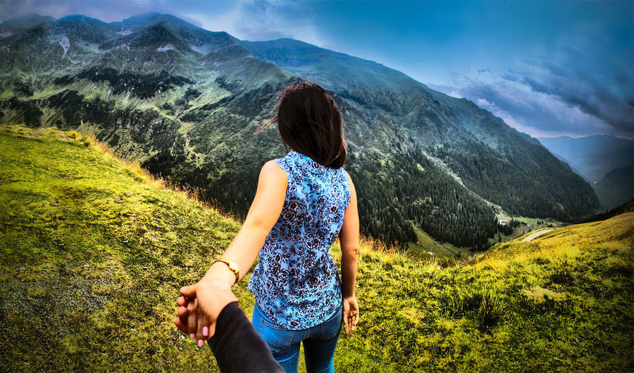 The Great Outdoors - 2018 EyeEm Awards Transylvania Woman Beauty In Nature Fagaras Great Huge Looking At View Mountain Mountain Range Nature One Person Outdoors Peak Rear View Top View The Traveler - 2018 EyeEm Awards