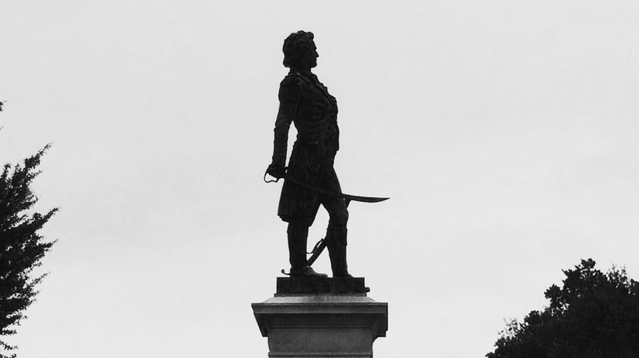 Statue in Fredericksburg. Statue Sculpture Human Representation The Architect - 2017 EyeEm Awards EyeEmNewHere Silhouette Grey_Scale_Edition Bnw Black And White Male Likeness Creativity Low Angle View Female Likeness Craft Sky Outdoors Monument Day Travel Destinations Tree Clear Sky Full Length Built Structure No People Architecture