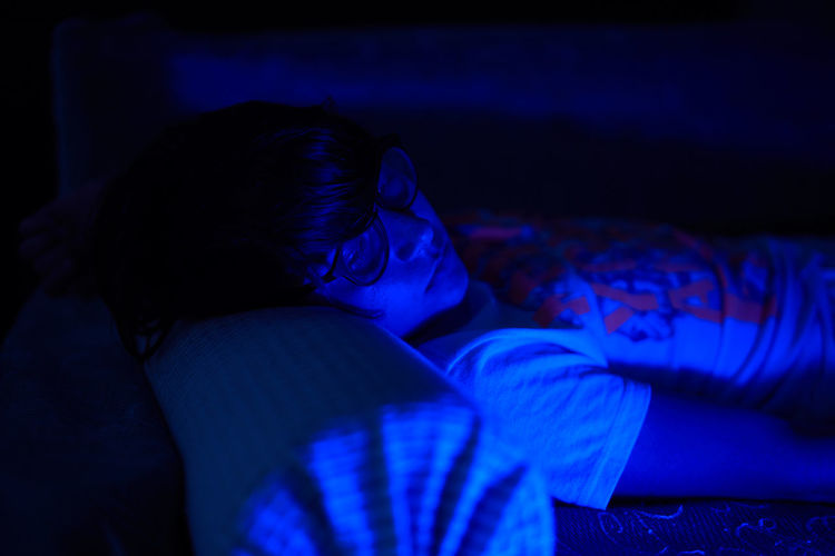 Adult Bed Bedroom Blue Dark Domestic Room Furniture Indoors  Leisure Activity Lifestyles Lying Down Night One Person Real People Relaxation Resting Sleeping Women Visual Creativity This Is My Skin The Portraitist - 2018 EyeEm Awards HUAWEI Photo Award: After Dark A New Perspective On Life Capture Tomorrow