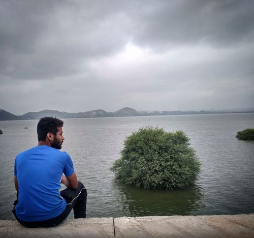 Innerpeace Getting Some Rest Lakeside Beauty Hometown Memories One Man Only Mature Adult Only Men One Person Sitting One Mature Man Only Casual Clothing Relaxation Contemplation Rear View Adult Adults Only Lake People Mature Men Cloud - Sky Full Length Outdoors T-shirt Looking At View