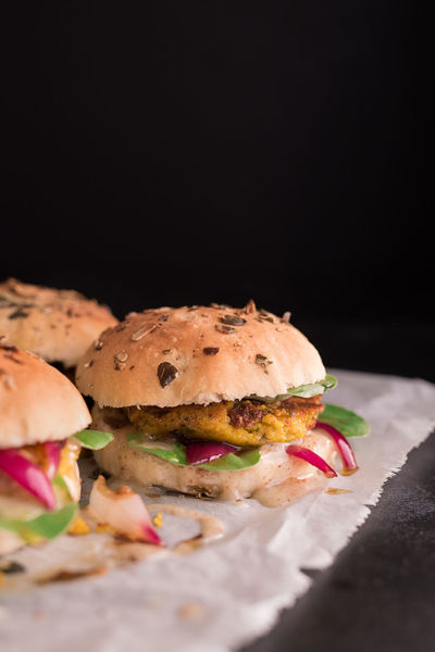vegan burger buns with vegan pumpkin-chickpeak patty infront of a black background   daylight foodphotography Hokkaido Homemade Homemade Food Selfmade Baked Baking Paper Black Background Bread Bun Burger Chickpeas Close-up Daylight Photography Food Food And Drink Food Photography Foodphotography Freshness Hamburger No Meat No People Ready-to-eat Tasty Yummy