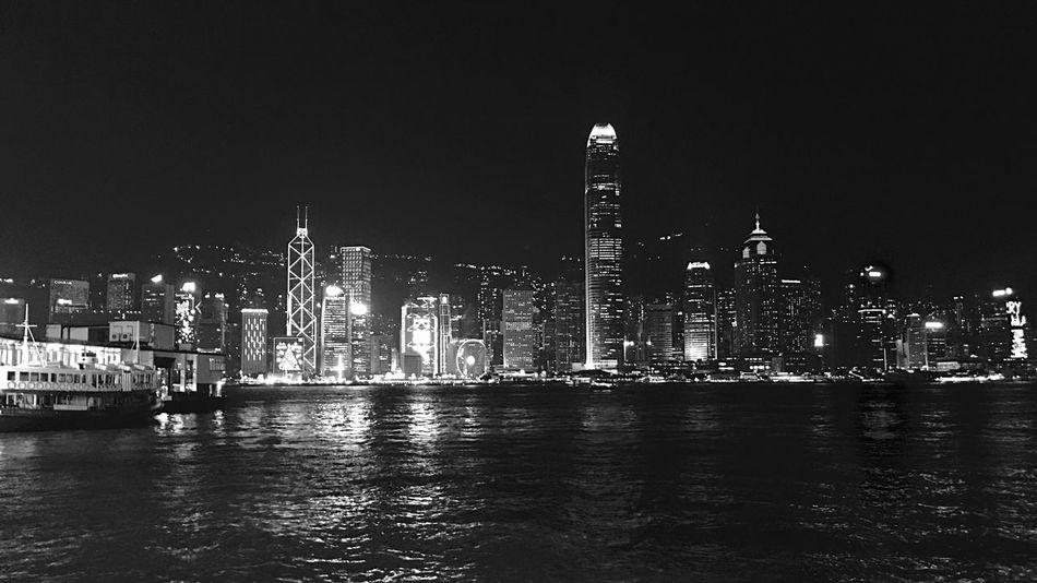Architecture Building Exterior City Built Structure Skyscraper Facade Lighting Black & White Black And White Pattern, Texture, Shape And Form Light And Shadow IPhoneography Urban Landscape Victoria Harbour City Lights City At Night Buildings & Sky Water Night Hong Kong Skyline Illuminated Waterfront Urban Skyline Outdoors Travel Destinations Sky