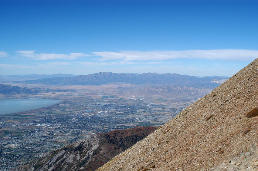 View of Utah Lake, Provo, and Utah County from the top of Mt Timpanogos, 2nd highest mountain in Wasatch Mountain Range.View of Utah Valley from the top of Timp. Utah Lake as seen from high mountian Beauty In Nature Blue Day Landscape Mountain Mountain Range Nature No People Outdoors Physical Geography Scenics Sky Timpanogos Timpanogosutah Tranquil Scene Tranquility Travel Destinations