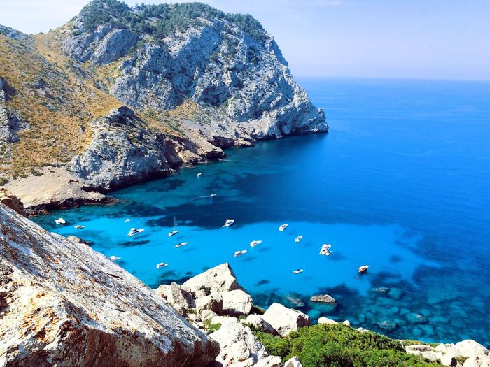 Water Sea Tranquil Scene Scenics Tranquility Blue Beauty In Nature Nature Rock Formation Mountain Rocky Day Sailing Rocky Mountains Non-urban Scene Outdoors Rock Rocky Mountain Cliff Turquoise Summertime Summer Views From Above  Boats Mediterranean
