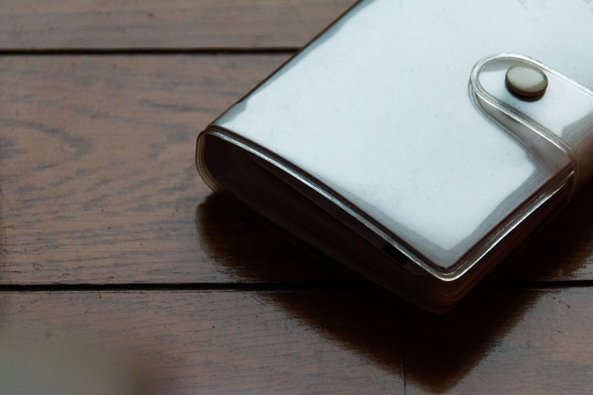 Card Case Casual Look Close-up Daily Life Floor Flooring Ideas Lifestyles Memorandum Notebook Overhead View Part Of Pocketbook Selective Focus Simple Stationery Still Life Wooden