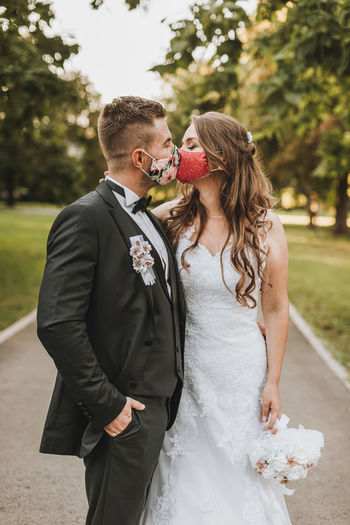 Wedding couple with face mask in covid-19 time