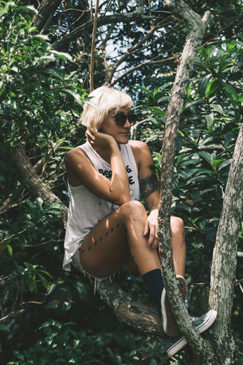 Agnes hanging out in the trees on top of Dois Irmaos. Blond Hair Climbing Day Forest Girl Jungle Leisure Activity Lifestyle Lifestyles Nature One Person Outdoors People Portrait Portrait Of A Woman Portrait Photography Pose Real People Shades Sunglasses The Portraitist - 2017 EyeEm Awards Tree Woman Young Adult Young Women Live For The Story BYOPaper! EyeEm Selects Visual Creativity The Traveler - 2018 EyeEm Awards The Portraitist - 2018 EyeEm Awards Skate Photography: Same Tricks, New Perspectives