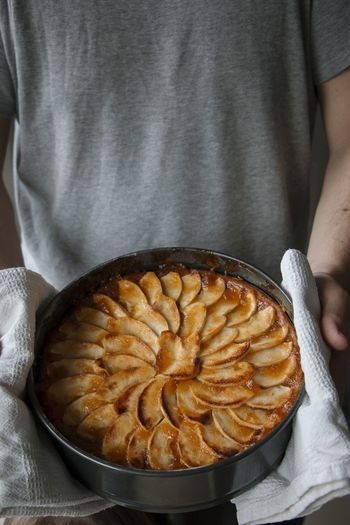Midsection of man holding apple pie