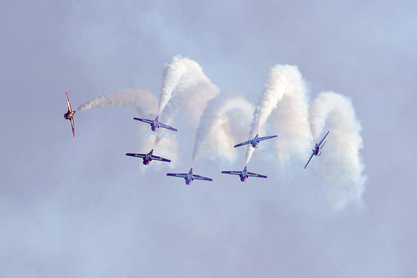 Snowbirds At The Air Show Aerobatics Air Vehicle Airplane Airshow Cloud - Sky Cooperation Fighter Plane Flying Low Angle View Mid-air Military Airplane Mode Of Transportation Motion No People on the move Order Outdoors Plane Sky Smoke - Physical Structure Teamwork Transportation Vapor Trail