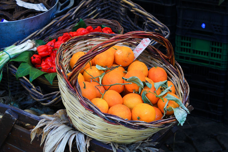 High angle view of oranges in basket for sale