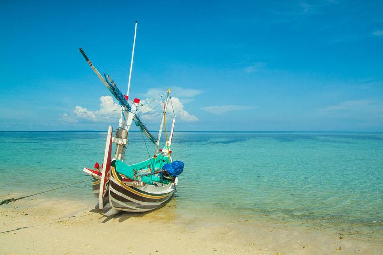 Boat On Beach Against Sky