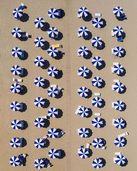 Aerial view of beach umbrellas on beach