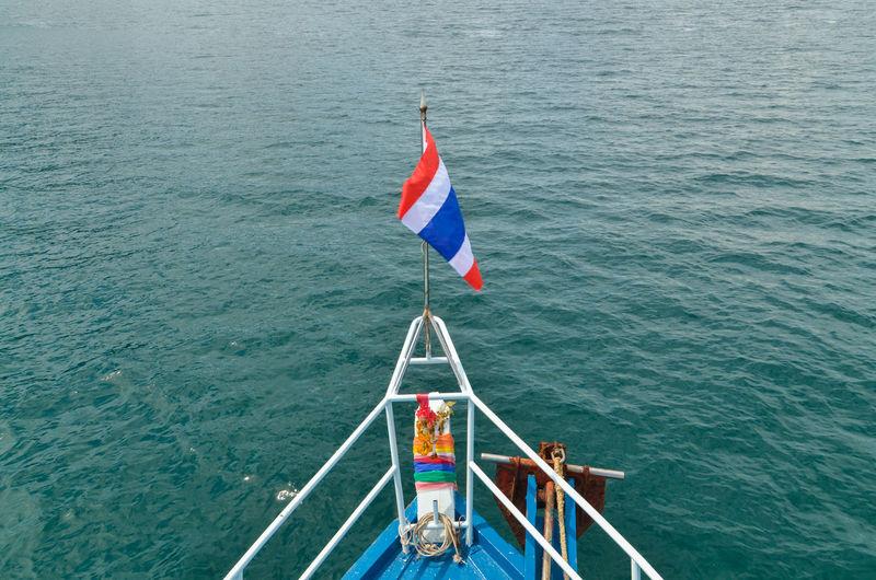 Thai flag on boat in sea