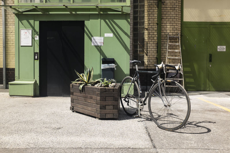 Bicycle standing in front of a building