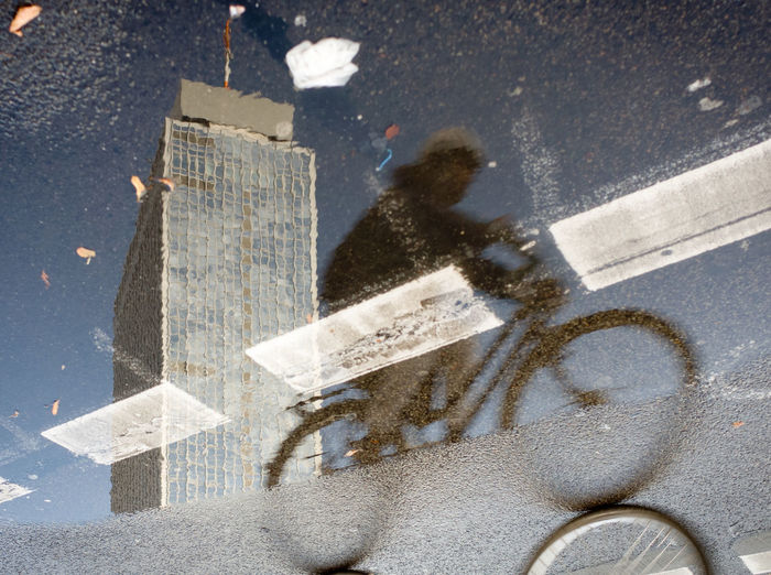 High Reflection Bycicle City Day Direction Flip Highrise Outdoors Reflection_collection Road Marking Speed Street Mobility In Mega Cities
