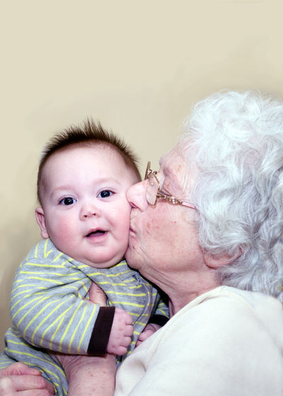 Grandma kisses chubby cheeks on a happy baby Kiss Baby Babyhood Bonding Care Caregiver Child Childhood Cute Emotion Family Grandchild Grandmother Headshot Innocence Looking At Camera Love People Portrait Positive Emotion Real People Senior Adult Togetherness Two People Young Love Is Love The Portraitist - 2018 EyeEm Awards