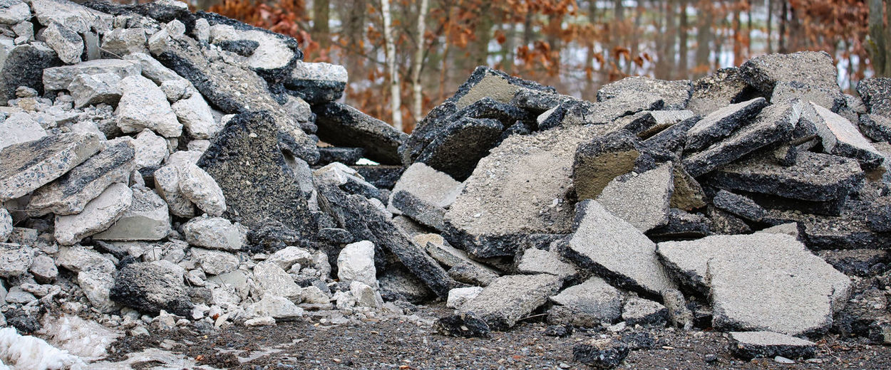 Stack of rocks on field during winter