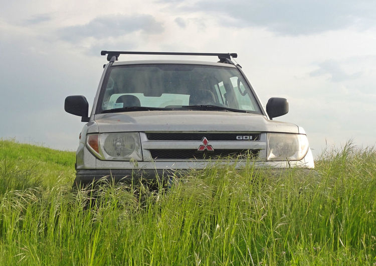 Pajero Pinin in the field Car Day Field Grass Landscape Mitsubishi No People Outdoors Pajero