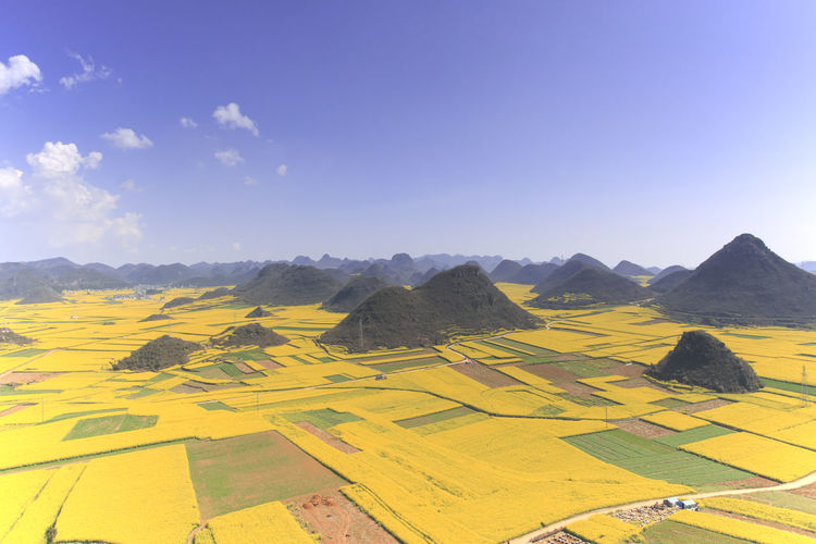 High angle view of fields against sky