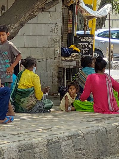 Rear view of people sitting at temple
