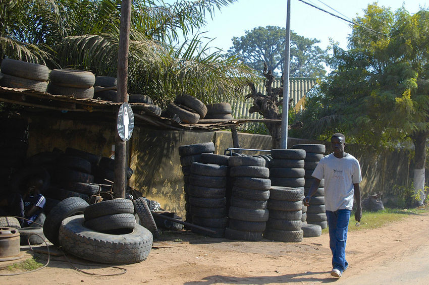 Ziguinchor Casamance Senegal City City Life Tires West Africa Ziguinchor Abundance Africa Car Tire Casamance Day Large Group Of Objects One Person Outdoors Senegal Stack