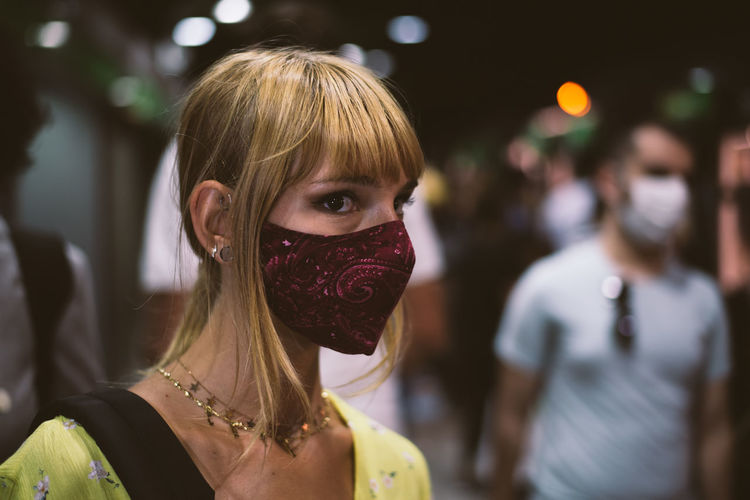 Close-up of woman wearing mask standing outdoors