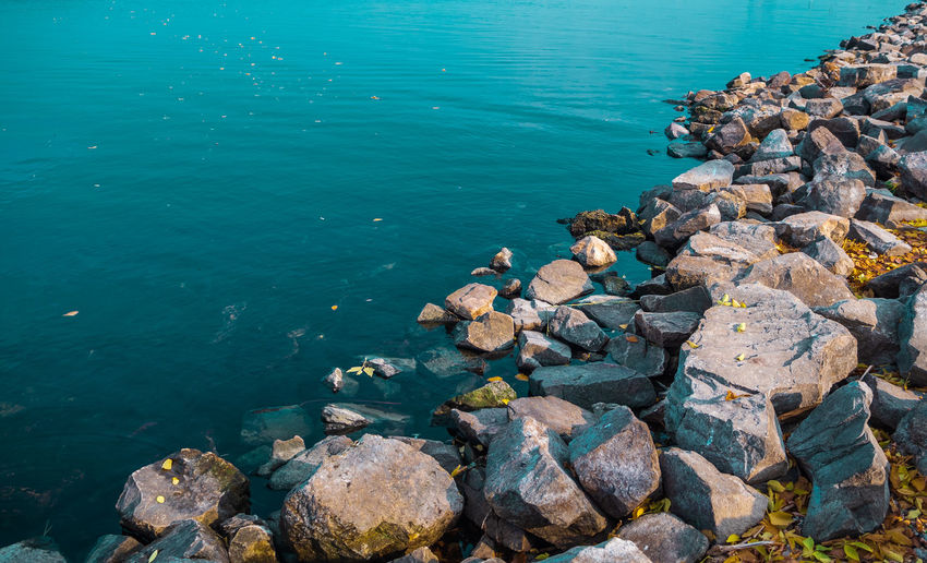 Rock Solid Water Rock - Object Sea Nature Beauty In Nature Tranquility No People High Angle View Day Tranquil Scene Outdoors Stone - Object Stack Scenics - Nature Beach Blue Sunlight Marine Turquoise Colored Groyne