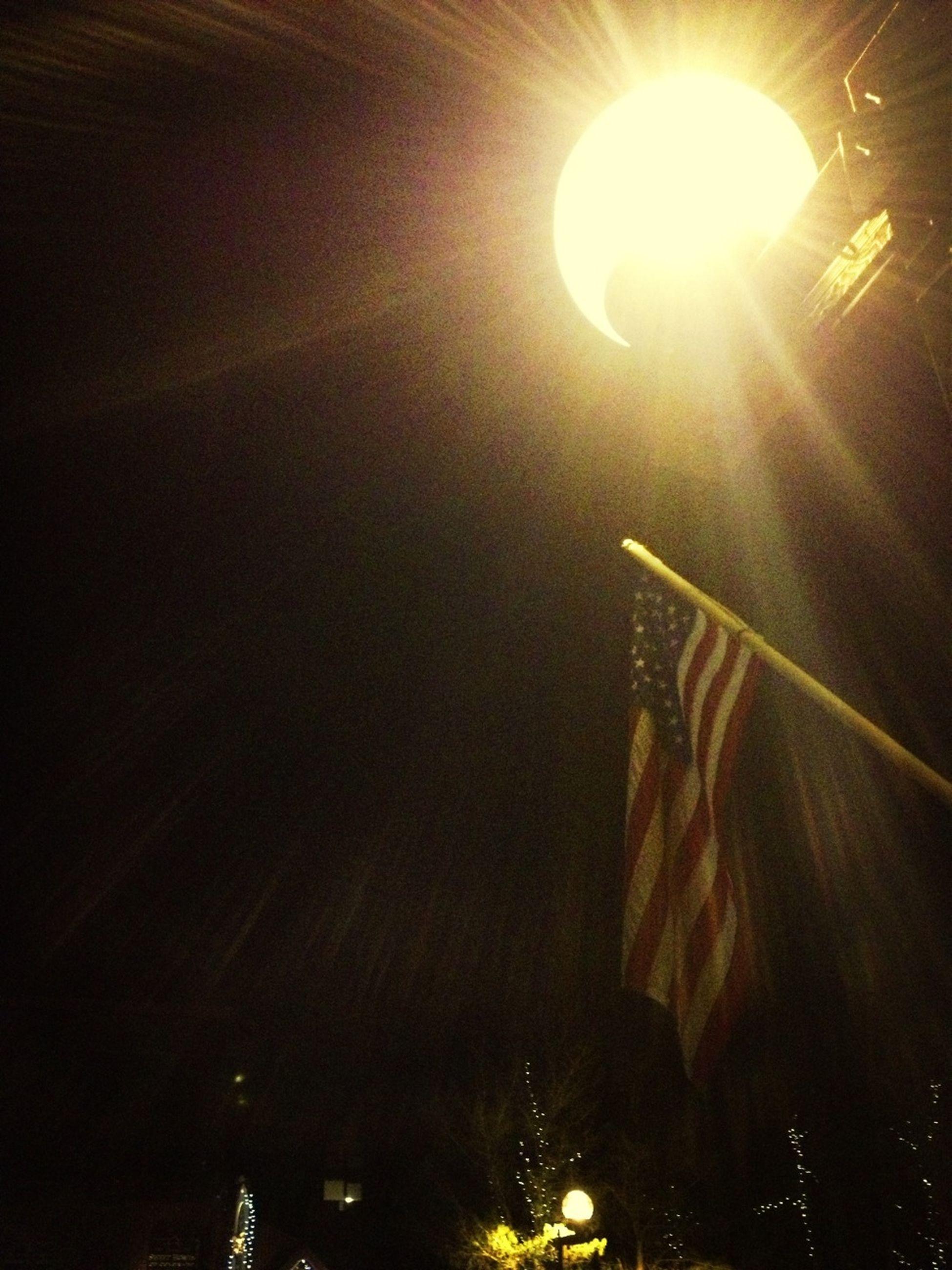 illuminated, low angle view, night, lens flare, lighting equipment, glowing, light - natural phenomenon, sun, sunbeam, no people, street light, sunlight, sky, bright, light beam, shiny, electricity, indoors, electric light