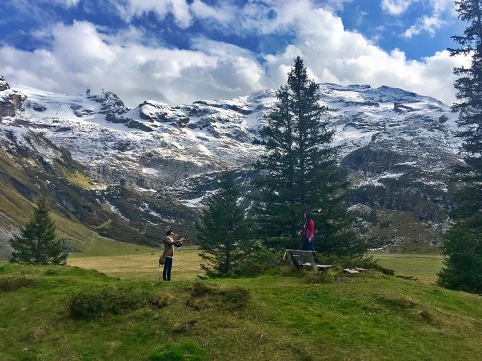 Lost in the Landscape Travel Photography Alps Landscape Travel Destinations Beauty In Nature Nature Mountain Scenics Mountain Range Tranquility Two People Leisure Activity Cloud - Sky Lifestyles Tranquil Scene Sky Real People Adventure Togetherness Outdoors Landscape Shades Of Winter