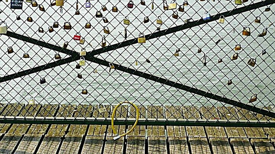 2011 Souvenirs de ParisChainlink Fence Protection Fence Security Safety Metal No People Day Outdoors Forbidden Close-up Horizontal Lock Architecture Sky Love Locks Bridge Locks Le Pont Des Arts Paris, France  Paris