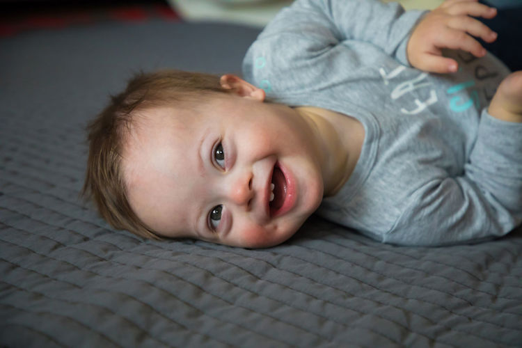 Babyboy Babyhood Childhood Close-up Day Down Syndrome Downsyndrome Illness Indoors  Lifestyles Looking At Camera Mental Health  One Person Portrait Real People