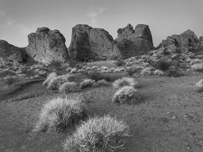 Black and white of large rock formations at Valley of fire State Park Black And White Rock Formation Rock - Object Geology Nature Physical Geography Beauty In Nature Tranquility Travel Destinations Clear Sky Outdoors Scenics Arid Climate Tranquil Scene Sky No People Desert Landscape Day