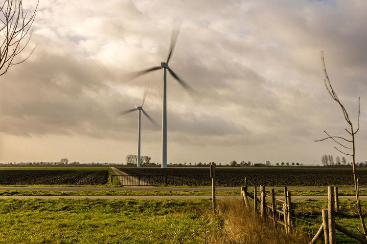Wind turbines in the wind near Nummer Een. EyeEm Market © Renewable Energy Wind Turbine Landscape Field Wind Power Agriculture SONY A7ii Zeeuws Vlaanderen Zeeland  The Netherlands Action Shot  Stormy Sky