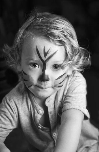 Close-up portrait of cute boy with face paint