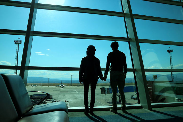 Rear view of silhouette people at airport