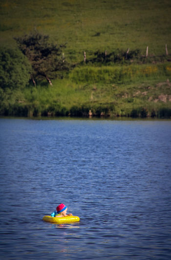Alone Time Swimming Child Day Floating On Water Lake Lake View Leisure Activity Nature Nautical Vessel Outdoors Real People Rubber Ring Water Waterfront Be. Ready. Summer Exploratorium