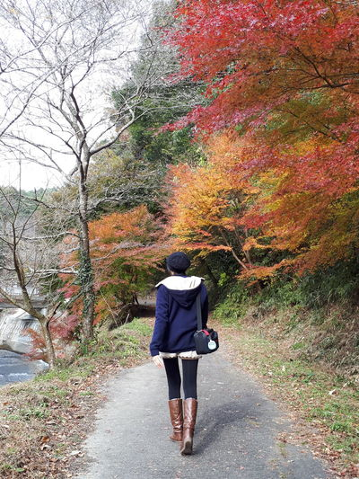 Keep walking Walking Real People One Person Rear View Day Women Outdoors Road Nature Tree Adult Only Women People Sky Autumn🍁🍁🍁 Red Leaves Yellow Leaves Green Leaves Way Forward Walking Alone Walkway Young Girl Back Way Brown Boots