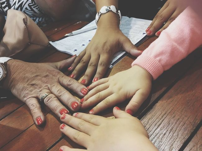 Generations of Hands Hand EyeEm Selects Human Hand Human Body Part Hand Women Adult Nail Ring People Togetherness Body Part High Angle View Nail Polish Indoors  Real People Females Finger Manicure Positive Emotion