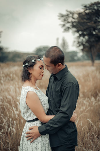 Young couple standing on field