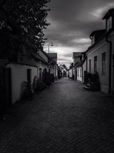 Walking on cobbled roads MADE IN SWEDEN Architecture_bw Visby